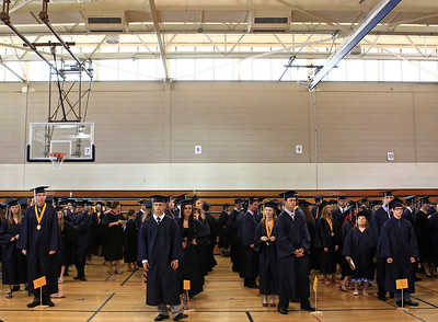 Brett Moist for the Northwest Herald Graduating students line up to get ready for their Senior Graduation Ceremony at Cary Grove High School on Saturday.