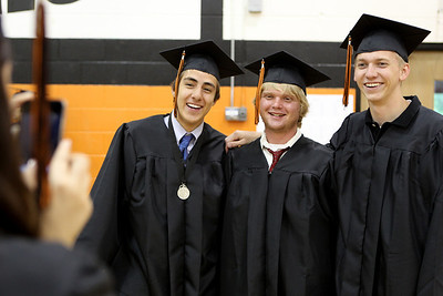 Mike Greene - mgreene@shawmedia.com Brandon Solarte, Nick Sistko and Tyler Schaefer pose for a photo prior to the start of commencement ceremonies for Crystal Lake Central Saturday, May 26, 2012 in Crystal Lake.