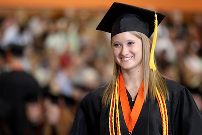 Mike Greene - mgreene@shawmedia.com Rachel Bremicker poses for a photo after receiving her diploma during commencement ceremonies for Crystal Lake Central Saturday, May 26, 2012 in Crystal Lake.