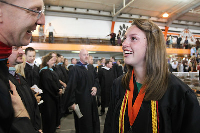 Mike Greene - mgreene@shawmedia.com Kayla Heyn speaks with teacher Mike Smalley following commencement ceremonies for Crystal Lake Central Saturday, May 26, 2012 in Crystal Lake.
