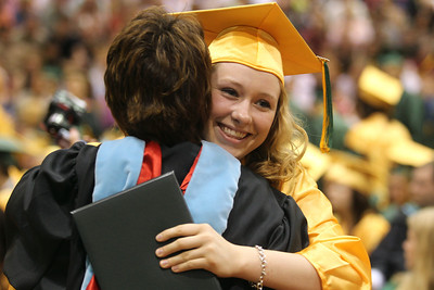 Mike Greene - mgreene@shawmedia.com Kayla Fitzgerald hugs Crystal Lake South principal Marsha Potthoff after receiving her diploma during commencement ceremonies for Crystal Lake South Saturday, May 26, 2012 in Crystal Lake.