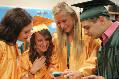 Mike Greene - mgreene@shawmedia.com Nicole Szeszel, Melissa Talaga, Haley Smith and Mike Sottile laugh at photos taken before the start of commencement ceremonies for Crystal Lake South Saturday, May 26, 2012 in Crystal Lake.