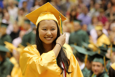 Mike Greene - mgreene@shawmedia.com Crystal Lake South Valedictorian Carol Feng switches the side of her tassle after receiving her diploma during commencement ceremonies for Crystal Lake South Saturday, May 26, 2012 in Crystal Lake. Feng graduated with a 4.70 GPA and will attend Northwestern University majoring in Pre-Med.