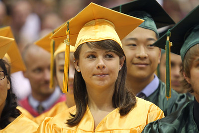 Mike Greene - mgreene@shawmedia.com Elizabeth Adams listens as members of the student council speak during commencement ceremonies for Crystal Lake South Saturday, May 26, 2012 in Crystal Lake.