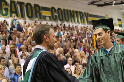 Mike Greene - mgreene@shawmedia.com Robert Baran shakes hands with a member of the faculty before receiving his diploma during commencement ceremonies for Crystal Lake South Saturday, May 26, 2012 in Crystal Lake.