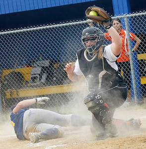 Candace H. Johnson – Shaw Suburban Media McHenry's Mikaela Mitsch shows the ball after putting the tag on Warren's Amy Ricci for an out at home plate in the fifth inning during the Class 4A Regional final at Warren Township High School in Gurnee. McHenry won 6-2.