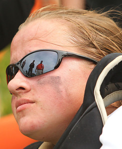 Candace H. Johnson – Shaw Suburban Media McHenry's catcher, Mikaela Mitsch listens to her coaches, Anna Snyder, assistant, and John DiFrancesca, head coach, after their team beat Warren 6-2 during the Class 4A Regional final at Warren Township High School in Gurnee.