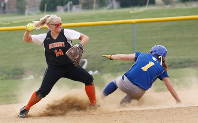 Candace H. Johnson – Shaw Suburban Media McHenry's Beth Petrunich forces an out on second against Warren's Megan Sowa in the fifth inning during the Class 4A Regional final at Warren Township High School in Gurnee. McHenry won 6-2.