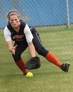 Candace H. Johnson – Shaw Suburban Media McHenry's Dana Walsh fields a ground ball against Warren in the fifth inning during the Class 4A Regional final at Warren Township High School in Gurnee.