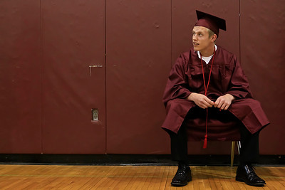 Brett Moist for the Northwest Herald Mike Ward nervously awaits his time to graduate high school before the Senior Graduation Ceremony at Prairie Ridge High School on Saturday.