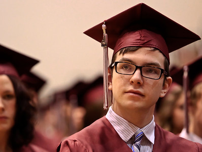 Brett Moist for the Northwest Herald William Dyer III looks up at the crowd during the 2012 Senior Graduation Ceremony at Prairie Ridge High School on Saturday.