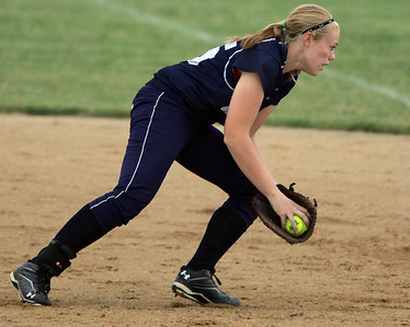 H. Rick Bamman - hbamman@shawmedia.com Cary Grove's Sarah Kendeigh fields a infield grounder in the third inning Saturday against Jacobs at the IHSA Class 4A Huntley regional softball game.