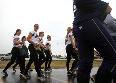 H. Rick Bamman - hbamman@shawmedia.com Players head for shelter after lightning at the  IHSA Class 4A Huntley regional softball game Saturday morning.