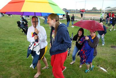 H. Rick Bamman - hbamman@shawmedia.com Softball fans head for shelter after lighting at the IHSA Class 4A Huntley regional softball game.