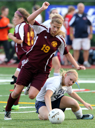 H. Rick Bamman - hbamman@shawmedia.com Richmond Burton's Sam Boettjer (19) avoids a falling Sara Morgensen (9) of Lisle while driving up field.