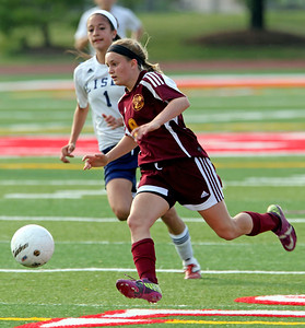 H. Rick Bamman - hbamman@shawmedia.com Richmond-Burton's Amanda Hoglund out runs Lisle defender Val Melo to score in the first half of the third place girls soccer game during the IHSA Class 1A State Finals Saturday May 26, 2012.