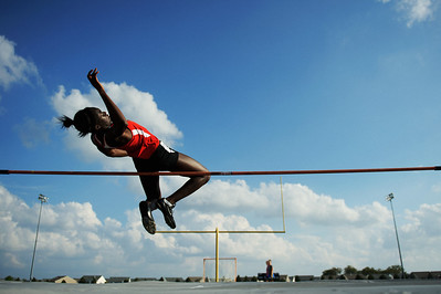 Daniel J. Murphy - dmurphy@shawmedia.com  Huntley's Omo Tseumah clears 5 1/2 feet in the high jump during the Fox Valley Conference girls track meet Thursday May 3, 2012 at Huntley High School.