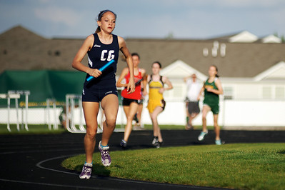 Daniel J. Murphy - dmurphy@shawmedia.com  Cary-Grove's Talia Duzey leads in the 800-meter relay during the Fox Valley Conference girls track meet Thursday May 3, 2012 at Huntley High School.