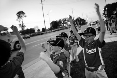 Daniel J. Murphy - dmurphy@shawmedia.com  Tyler Hajduk, 9, (right) of Huntley cheers in celebration of getting a passing semi to honk his horn Thursday May 3, 2012 at the Dairy Mart in Huntley. Tyler and his little league baseball teammates were out celebrating their first win of the season with ice cream and dinner.