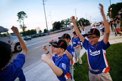 Daniel J. Murphy - dmurphy@shawmedia.com  Tyler Hajduk, 9, (right) of Huntley cheers in celebration of getting a passing tucker to honk his horn Thursday May 3, 2012 at the Dairy Mart in Huntley.