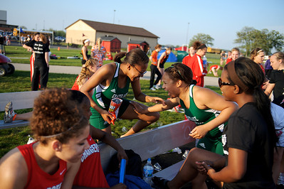 Daniel J. Murphy - dmurphy@shawmedia.com  Grayslake runners Miranda Adams,17, Amanda Palmer,18, and Destinee Moore, 17, joke around while waiting for the 100-meter dash to start during the Fox Valley Conference girls track meet Thursday May 3, 2012 at Huntley High School.