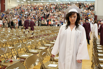 Mike Greene - mgreene@shawmedia.com Brittany Christensen finds her seat at the start of commencement ceremonies for Marengo Community High School Saturday, May 26, 2012 in Marengo.