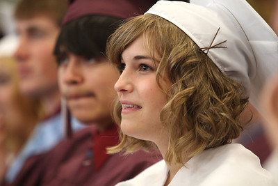 Mike Greene - mgreene@shawmedia.com Logan Garfield listens to the valedictorian's address during commencement ceremonies for Marengo Community High School Saturday, May 26, 2012 in Marengo.