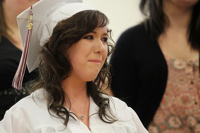 Mike Greene - mgreene@shawmedia.com Brittany Christensen gets emotional following her final choir performance at the school during commencement ceremonies for Marengo Community High School Saturday, May 26, 2012 in Marengo.