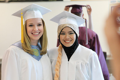 Mike Greene - mgreene@shawmedia.com Allyson Munneke and Mitha Mulyowahyudi pose for a photo prior to the start of commencement ceremonies for Marengo Community High School Saturday, May 26, 2012 in Marengo.