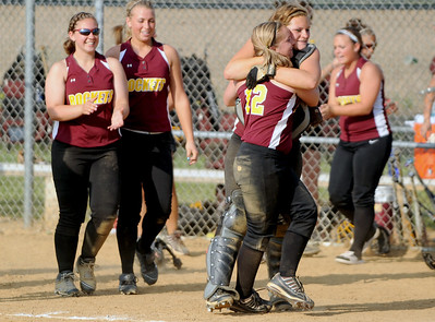 Sarah Nader - snader@shawmedia.com Richmond-Brton's Haylea Hoskins (center) hugs a teammate while celebrating their win against Johnsburg during Monday's IHSA 3A Regional Championship on May 28, 2012. Richmond-Burton won, 13-9.