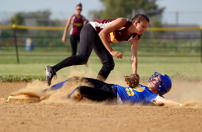 Sarah Nader - snader@shawmedia.com Richmond-Burton's Lily Mazzanti (left) tags out Johnsburg's Maycee Ward while she slid to second base during Monday's IHSA 3A Regional Championship on May 28, 2012. Richmond-Burton won, 13-9.
