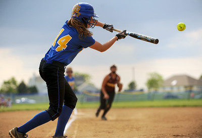 Sarah Nader - snader@shawmedia.com Johnsburg's Kayla Toussaint makes contact with the ball during Monday's IHSA 3A Regional Championship against Richmond-Burton in Johnsburg on May 28, 2012. Richmond-Burton won, 13-9.