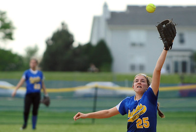 Sarah Nader - snader@shawmedia.com Johnsburg's Stephanie Cherwin jumps to catch a ball during Monday's IHSA 3A Regional Championship against Richmond-Burton in Johnsburg on May 28, 2012. Richmond-Burton won, 13-9.