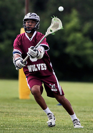 Sarah Nader - snader@shawmedia.com Prairie Ridge's Jordan Oates passes to a teammates during Wednesday's NILAX semifinals against Jacobs in Algonquin on May 30, 2012. Jacobs won, 9-8.