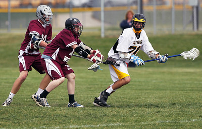 Sarah Nader - snader@shawmedia.com Prairie Ridge's Jacob Beckman (left) and Stuart Bryans guard Jacobs' Alex Crescenti while he brings the ball closer to the goal during Wednesday's NILAX semifinals in Algonquin on May 30, 2012. Jacobs won, 9-8.