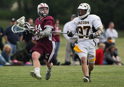 Sarah Nader - snader@shawmedia.com Jacobs' Zach White (right) guards Prairie Ridge's Tate Nolan during Wednesday's NILAX semifinals in Algonquin on May 30, 2012. Jacobs won, 9-8.