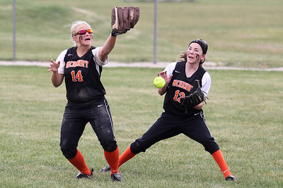 Mike Greene - mgreene@shawmedia.com McHenry's Beth Petrunich (left) and Carly Mattson watch as a fly ball drops in the outfield during the Class 4A Cary-Grove Sectional semifinals against Carmel Wednesday, May 30, 2012 in Cary. McHenry had 5 errors in their 9-8 loss to Carmel.