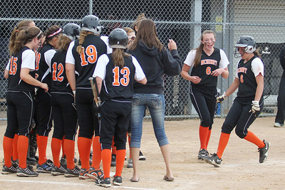 Mike Greene - mgreene@shawmedia.com McHenry's Kara Ekx takes the final steps before touching home plate after hitting a two-run home run during the Class 4A Cary-Grove Sectional semifinals against Wednesday, May 30, 2012 in Cary. Ekx home run put McHenry up 4-3, but Carmel won the game 9-8.