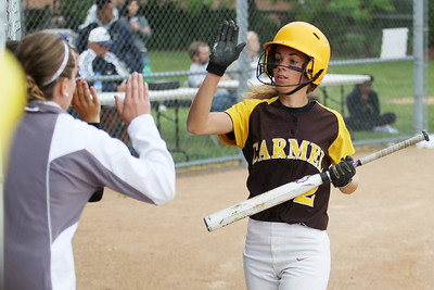 Mike Greene - mgreene@shawmedia.com Carmel's Kelley Dodge high-fives teammates after scoring a run during the first inning of the Class 4A Cary-Grove Sectional semifinals against McHenry Wednesday, May 30, 2012 in Cary. Carmel won the game 9-8.