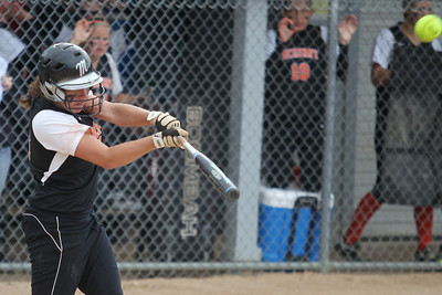 Mike Greene - mgreene@shawmedia.com McHenry's Kara Ekx follows through with a swing in the third inning of the Class 4A Cary-Grove Sectional semifinals against Carmel Wednesday, May 30, 2012 in Cary. Ekx hit a two-run homer on the swing to put McHenry up 4-3, but Carmel won the game 9-8.