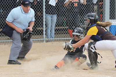 Mike Greene - mgreene@shawmedia.com McHenry's Lauren Splitt slides into the plate as Carmel's Skyler Zak applies a tag during the Class 4A Cary-Grove Sectional semifinals Wednesday, May 30, 2012 in Cary. Splitt was safe on the play, but Carmel won the game 9-8.