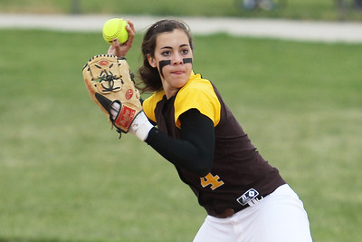 Mike Greene - mgreene@shawmedia.com Carmel's Kathleen Felicelli prepares to throw after fielding a ball on the infield during the Class 4A Cary-Grove Sectional semifinals against McHenry Wednesday, May 30, 2012 in Cary. Carmel won the game 9-8.