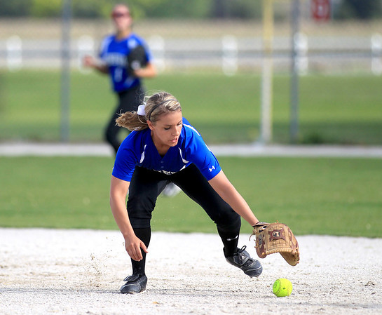Geneva's Elena Wright grabs a ball in the infield during their 3-0 loss at Batavia Wednesday.