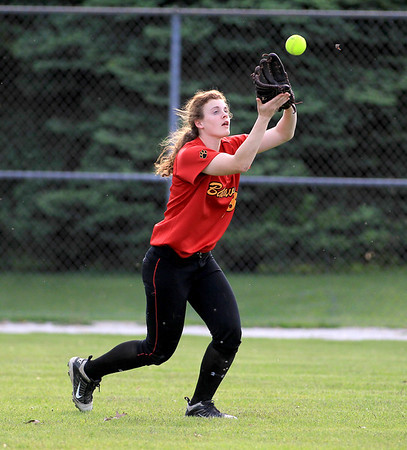 Batavia's Katie Ryan grabs a ball in center fieldl during their 3-0 home game win over Geneva Wednesday.