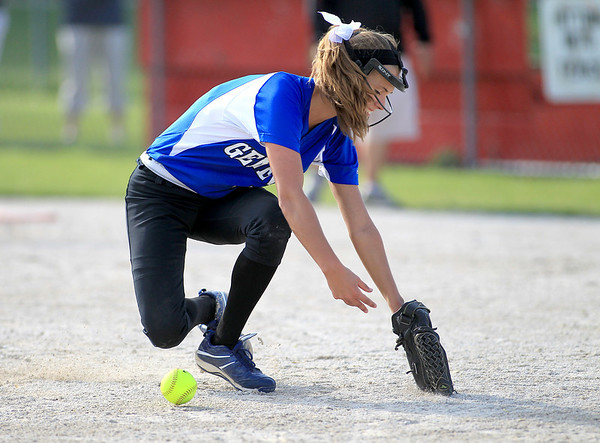 Geneva pitcher Natalie Erbe fumbles the ball in the infield during their 3-0 loss at Batavia Wednesday.