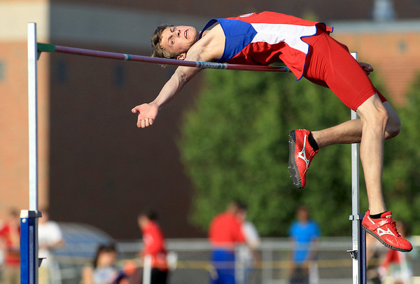 Marmion's Peter Stefanski clears the bar in the high jump competion during the IHSA Boys Track Sectional at St. Charles North High School Friday.