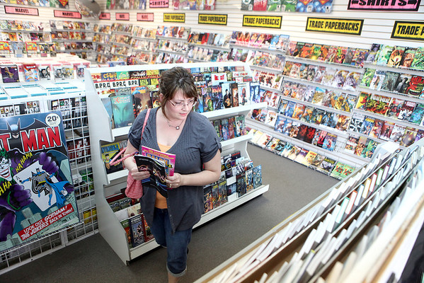 Julie Savitski of Hinckley shops for comic books at Graham Crackers Comics on Randall Road in St. Charles. The store will be participating in Commic Book Store today by giving away a selection of comics for free.