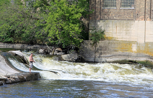 A man fishes at the Challenge Dam in Batavia Tuesday afternoon.