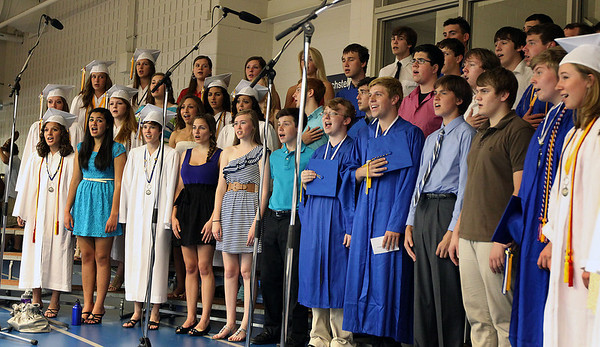 "Jeff Krage – For the Kane County Chronicle<br /> The Geneva High School choir sings the ""Star Spangled Banner"" during Sunday's graduation ceremonies.<br /> Geneva 5/27/12"