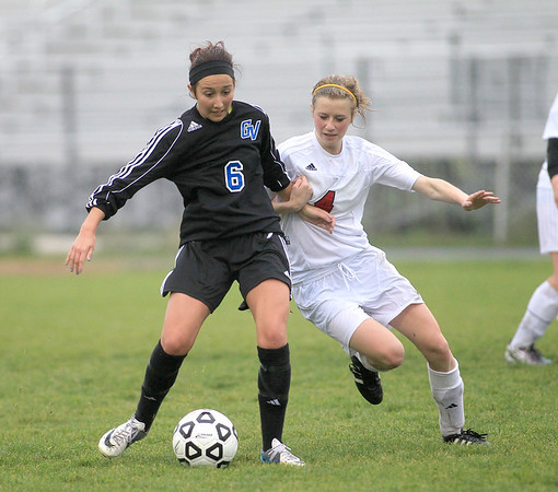 Geneva's Catherine Allon (left) and Batavia's Jordyn Kuhn go after the ball during their game at Batavia Tuesday.
